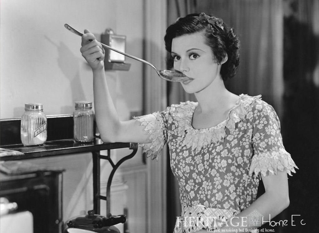 vintage homemaker in the kitchen tasting dinner before serving it to her family