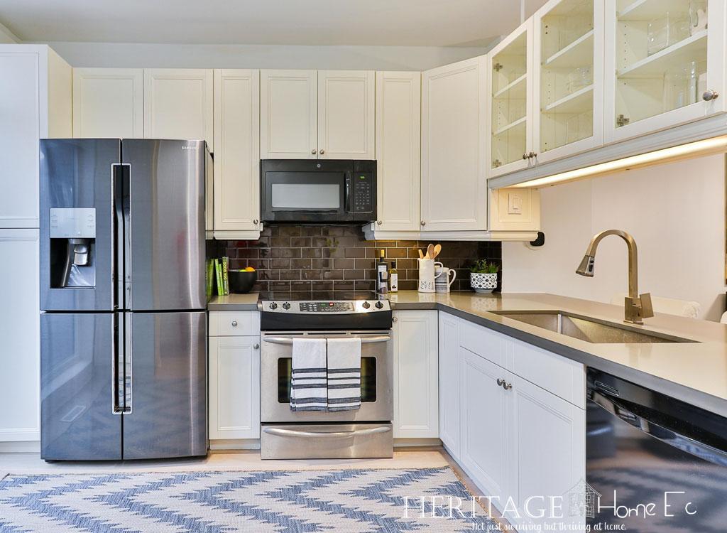 modern stainless steel appliances in white kitchen